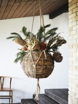 Round rattan suspension and macramé, bohemian style