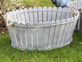 Large grey wooden pot with rope handles