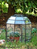 Large glass and metal green house Royal Chehoma, natural style