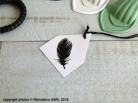 House paper card with feather. Madam Stoltz
