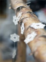 Paper cut on a string snow, christmas style, Ib Laursen
