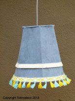 Hanging light blue fabric with pompoms, bohemian style